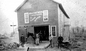 The Graham Bros blacksmith shop was on the south side of Grand River across the street from the Town Hall (Masonic Temple).  Photo ca. 1900.